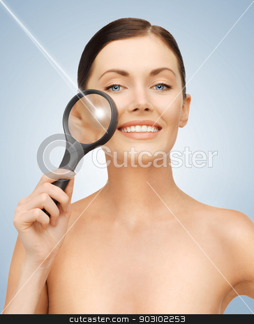 woman with magnifying glass and laser stock photo, bright picture of beautiful woman with magnifying glass and laser by Syda Productions