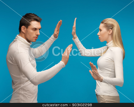 man and woman working with something imaginary stock photo, picture of man and woman working with something imaginary. by Syda Productions