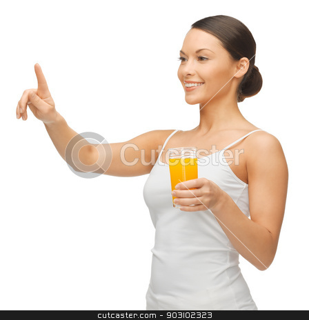 woman with glass of juice stock photo, woman holding glass of juice and working with something imaginary by Syda Productions
