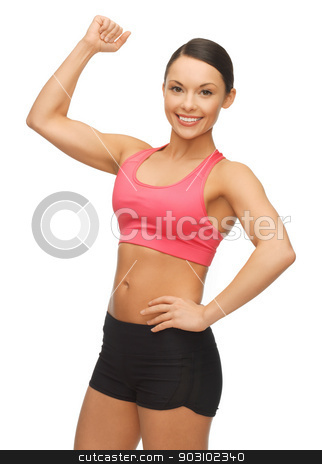 beautiful sporty woman stock photo, picture of beautiful sporty woman flexing her biceps by Syda Productions