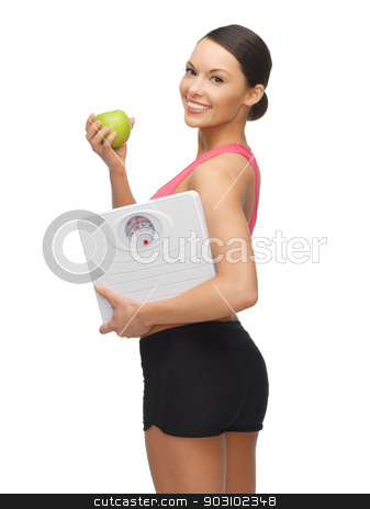 woman with apple and weight scale stock photo, picture of sporty woman with apple and weight scale by Syda Productions