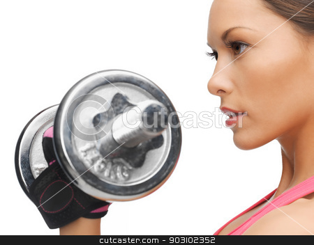 woman with dumbbells stock photo, picture of beautiful sporty woman with dumbbell by Syda Productions