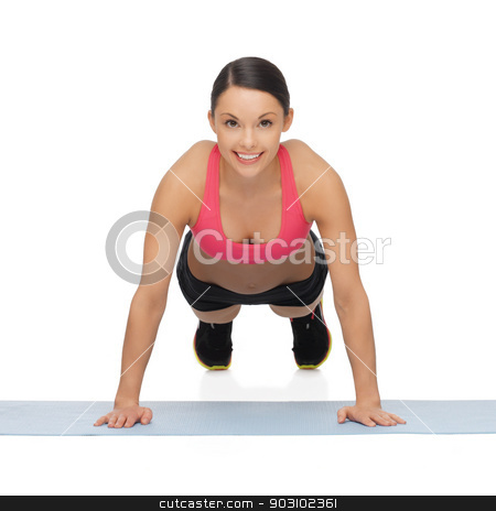 beautiful sporty woman doing exercise stock photo, picture of beautiful sporty woman doing exercise by Syda Productions
