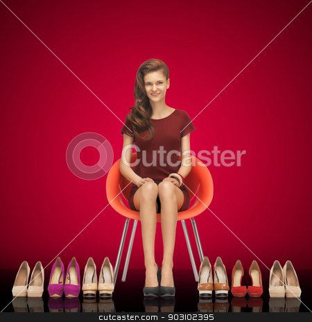 lovely teenage girl in red dress with shoes stock photo, picture of lovely teenage girl in red dress with shoes by Syda Productions