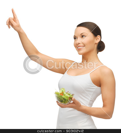 woman with salad stock photo, woman holding salad and working with something imaginary by Syda Productions