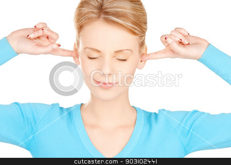 woman with fingers in ears stock photo, picture of woman with fingers in ears by Syda Productions