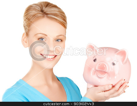 lovely woman with piggy bank stock photo, picture of lovely woman with piggy bank.. by Syda Productions