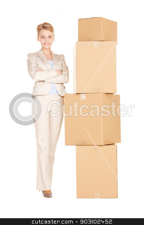 businesswoman with big boxes stock photo, picture of attractive businesswoman with big boxes by Syda Productions