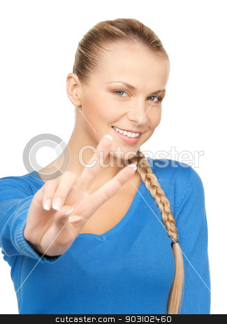 young woman showing victory sign stock photo, bright picture of young woman showing victory sign by Syda Productions