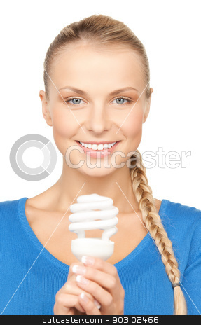 woman with energy saving bulb stock photo, picture of attractive woman with energy saving bulb by Syda Productions