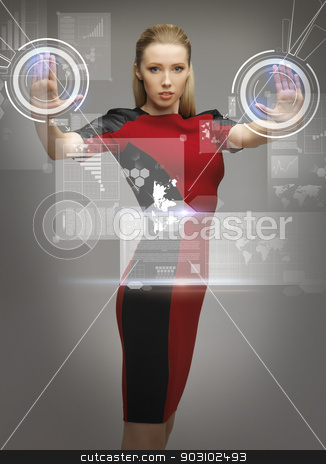woman working with virtual touchscreens stock photo, picture of futuristic woman working with virtual touchscreens by Syda Productions