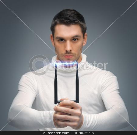 futuristic man with stun gun stock photo, bright picture of futuristic man with stun gun by Syda Productions