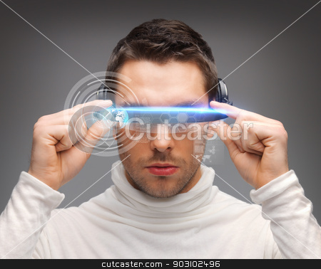 man with futuristic glasses stock photo, picture of handsome man with futuristic glasses. by Syda Productions