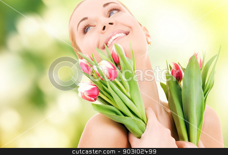 happy woman with flowers stock photo, picture of happy woman with flowers by Syda Productions