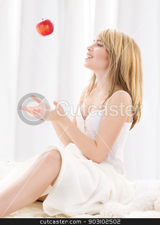 red apple stock photo, bright picture of lovely blonde with red apple by Syda Productions