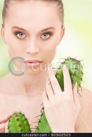 cactus stock photo, closeup portrait of beautiful woman with cactus by Syda Productions