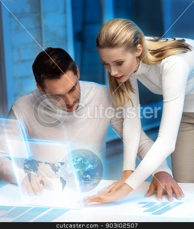 man and woman working with virtual screen stock photo, picture of man and woman working with virtual screen by Syda Productions