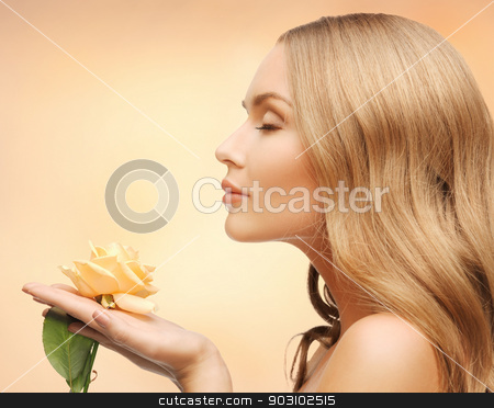 lovely woman with rose flower stock photo, bright picture of lovely woman with rose flower by Syda Productions