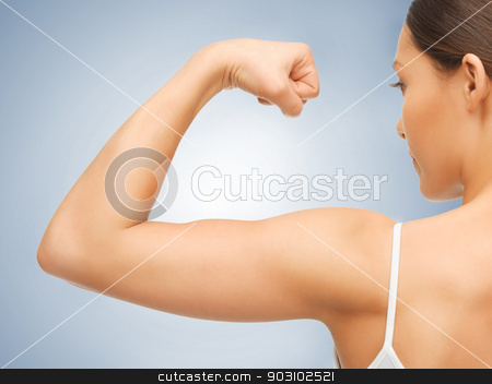 sporty woman flexing her biceps stock photo, closeup picture of sporty woman flexing her biceps by Syda Productions