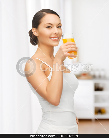 woman with glass of juice at kitchen stock photo, picture of beautiful woman with glass of juice at kitchen by Syda Productions