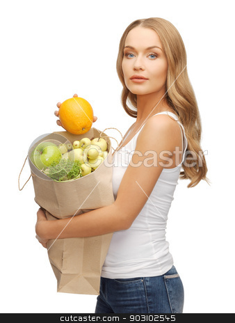 woman with bag stock photo, picture of woman with shopping bag and orange by Syda Productions
