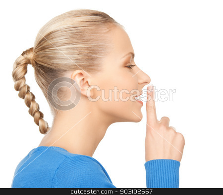happy woman with finger on lips stock photo, picture of happy woman with finger on lips by Syda Productions