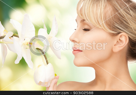 beautiful woman with orchid flower stock photo, picture of beautiful woman with orchid flower by Syda Productions