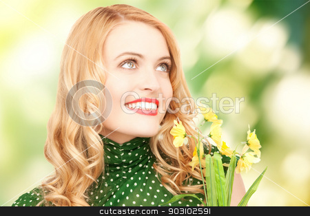 lovely housewife with flower stock photo, bright picture of lovely housewife with flower by Syda Productions