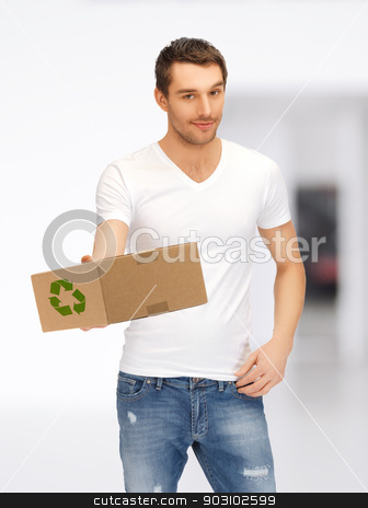handsome man with recyclable box stock photo, picture of handsome man with recyclable box by Syda Productions