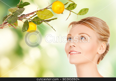 woman with lemon twig stock photo, picture of lovely woman with lemon twig by Syda Productions