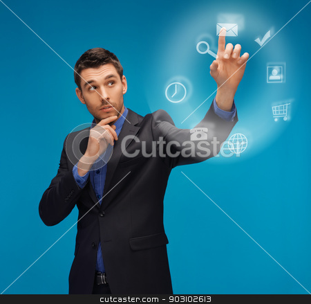 man in suit working with something imaginary stock photo, picture of man in suit working with something imaginary by Syda Productions