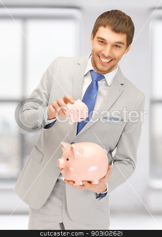 man with two piggy banks stock photo, picture of handsome man with two piggy banks by Syda Productions