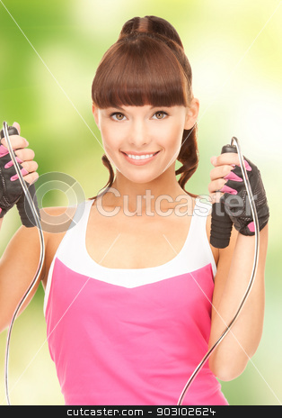 fitness instructor with jump rope stock photo, lovely fitness instructor with jump rope by Syda Productions