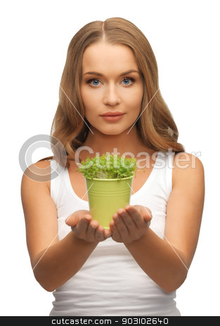 woman with green grass in pot stock photo, bright picture of woman with green grass in pot by Syda Productions