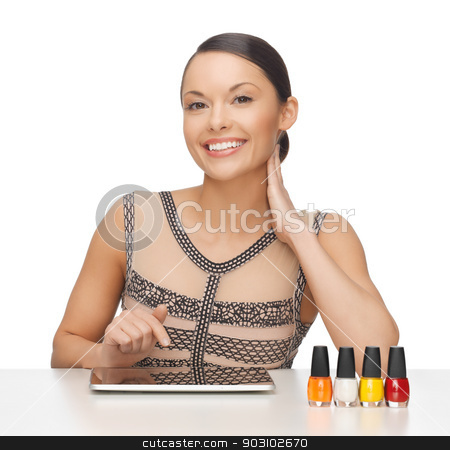 woman with with tablet pc stock photo, picture of woman with tablet pc and nail polish bottles by Syda Productions