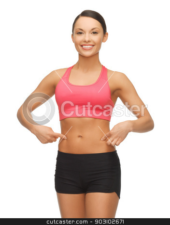 beautiful sporty woman stock photo, beautiful sporty woman pointing finger on her belly by Syda Productions