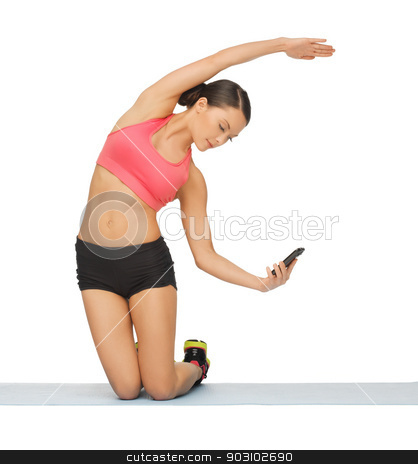 beautiful sporty woman doing exercise stock photo, beautiful sporty woman with smartphone doing exercise by Syda Productions