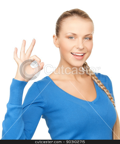 young woman showing ok sign stock photo, bright picture of young woman showing ok sign by Syda Productions