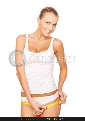 woman measuring her hips stock photo, picture of young beautiful woman measuring her hips by Syda Productions