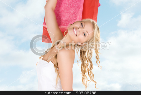 shopper stock photo, happy woman with shopping bags by Syda Productions