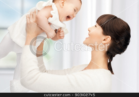 happy mother with adorable baby stock photo, picture of happy mother with adorable baby (focus on woman) by Syda Productions
