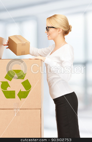 attractive businesswoman with big boxes stock photo, picture of attractive businesswoman with big boxes by Syda Productions