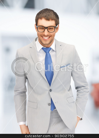 happy businessman in spectacles stock photo, portrait picture of happy businessman in spectacles by Syda Productions