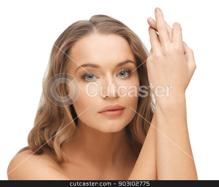 beautiful woman with long hair stock photo, face and hands of beautiful woman with long hair by Syda Productions