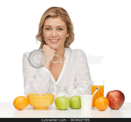woman with healthy breakfast stock photo, picture of woman in casual clothes with healthy breakfast by Syda Productions