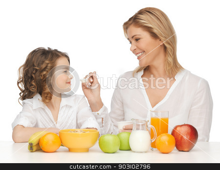 mother and daughter stock photo, picture of mother and daughter with healthy breakfast by Syda Productions