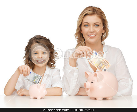 mother and daughter stock photo, mother and daughter with piggy banks and paper money by Syda Productions