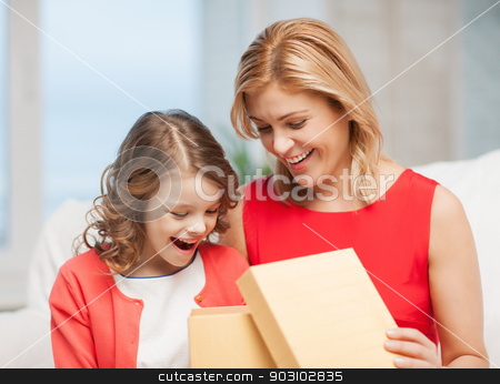 mother and daughter stock photo, picture of mother and daughter with box by Syda Productions