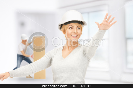 contractor and builder stock photo, picture of female contractor and builder working indoors by Syda Productions