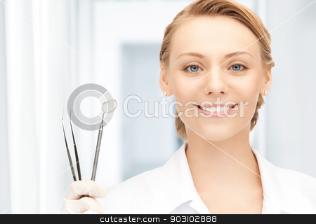 dentist with tools stock photo, picture of attractive female dentist with tools by Syda Productions